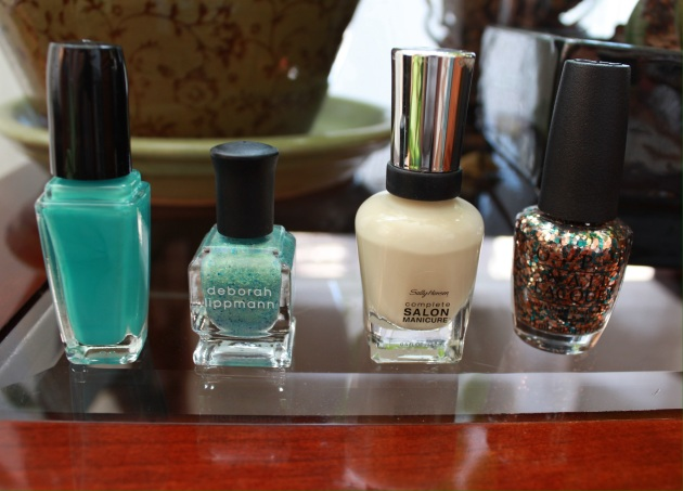 OPI's The Living Daylights, Sally Hansen's Dune, Dive In and Debora Lippman's Mermaid's Dream.